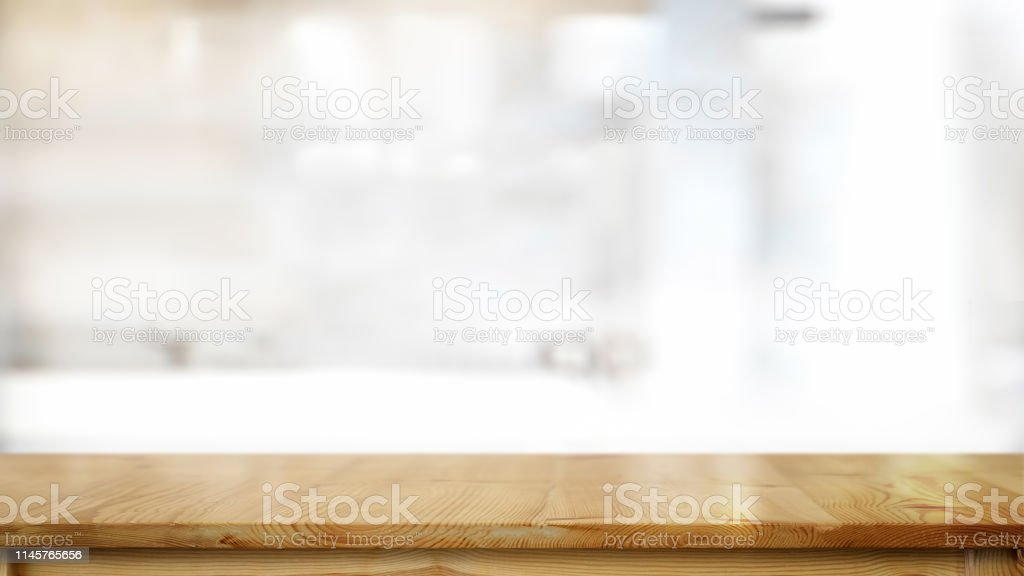 Empty wood table in kitchen room and copy space for product or food...