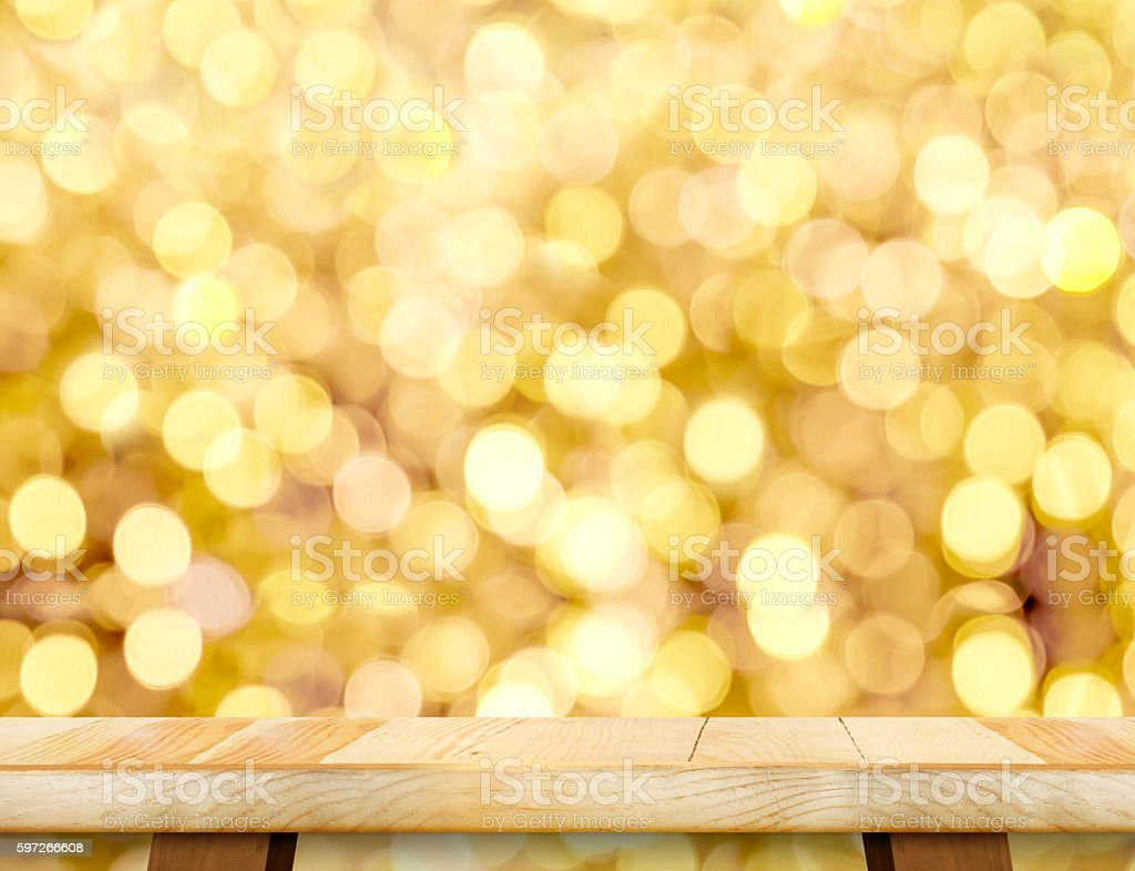 Empty wood table leg top with abstract gold bokeh light royalty-free stock photo