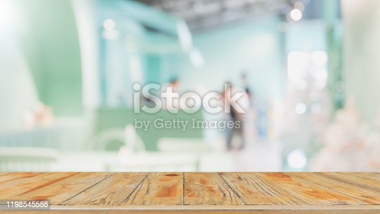 662984808 istock photo Empty wood table top and blur glass window interior restaurant banner mock up abstract background - can used for display or montage your products. 1198545555