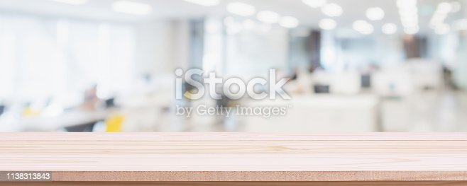 istock Empty wood table top and blur glass window wall in office building background - can used for display or montage your products. 1138313843