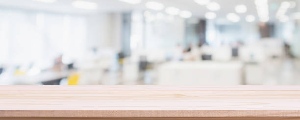 empty wood table top and blur glass window wall in office building background - can used for display or montage your products. - office background imagens e fotografias de stock