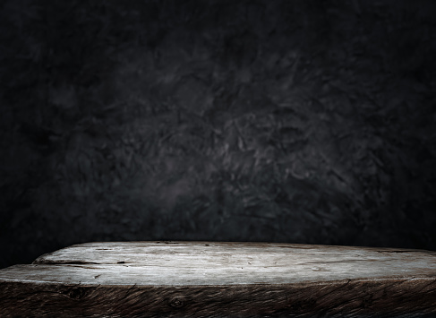 istock Empty wood table top counter on dark wall background.For create product display or design key visual 1168864615