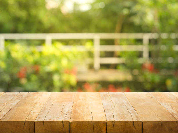 empty wood table top on blur abstract garden and house background - table stock photos and pictures
