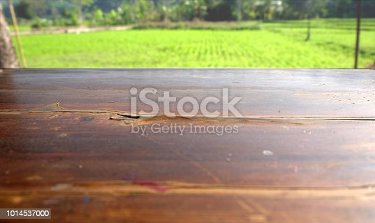 862429776 istock photo Empty wood table top on blur abstract green from garden in morning background. can be used for display or montage your products 1014537000