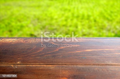 862429776 istock photo Empty wood table top on blur abstract green from garden in morning background. can be used for display or montage your products 1014537004