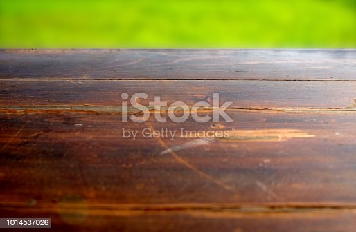 862429776 istock photo Empty wood table top on blur abstract green from garden in morning background. can be used for display or montage your products 1014537026