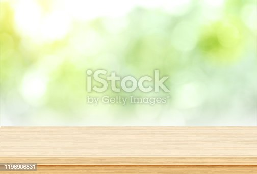 885452818 istock photo Empty wood table top on blur green from garden background, Template mock up for display of product 1196906831