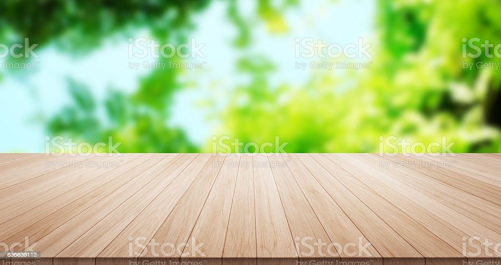 Empty wood table top on green background stock photo