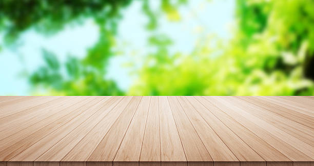 empty wood table top on green background - green background stock photos and pictures