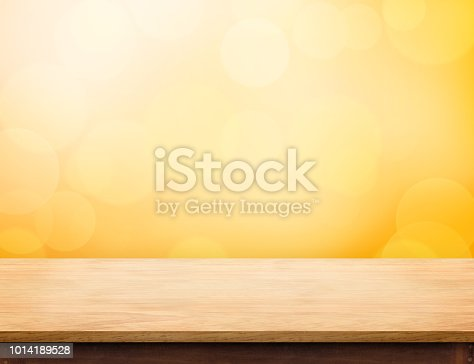istock Empty wood table top (food stand) with abstract blur orange bokeh background,Autumn backgorund,Mock up for display or montage of product,banner for advertise on online. 1014189528