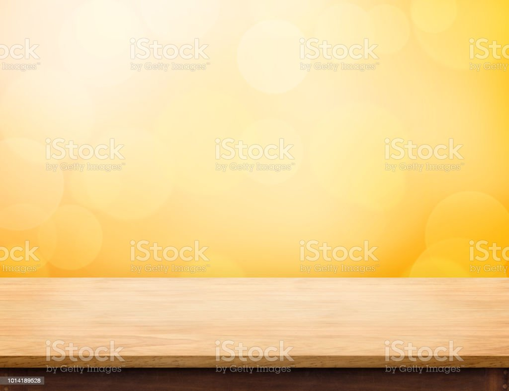 Empty wood table top (food stand) with abstract blur orange bokeh background,Autumn backgorund,Mock up for display or montage of product,banner for advertise on online. stock photo