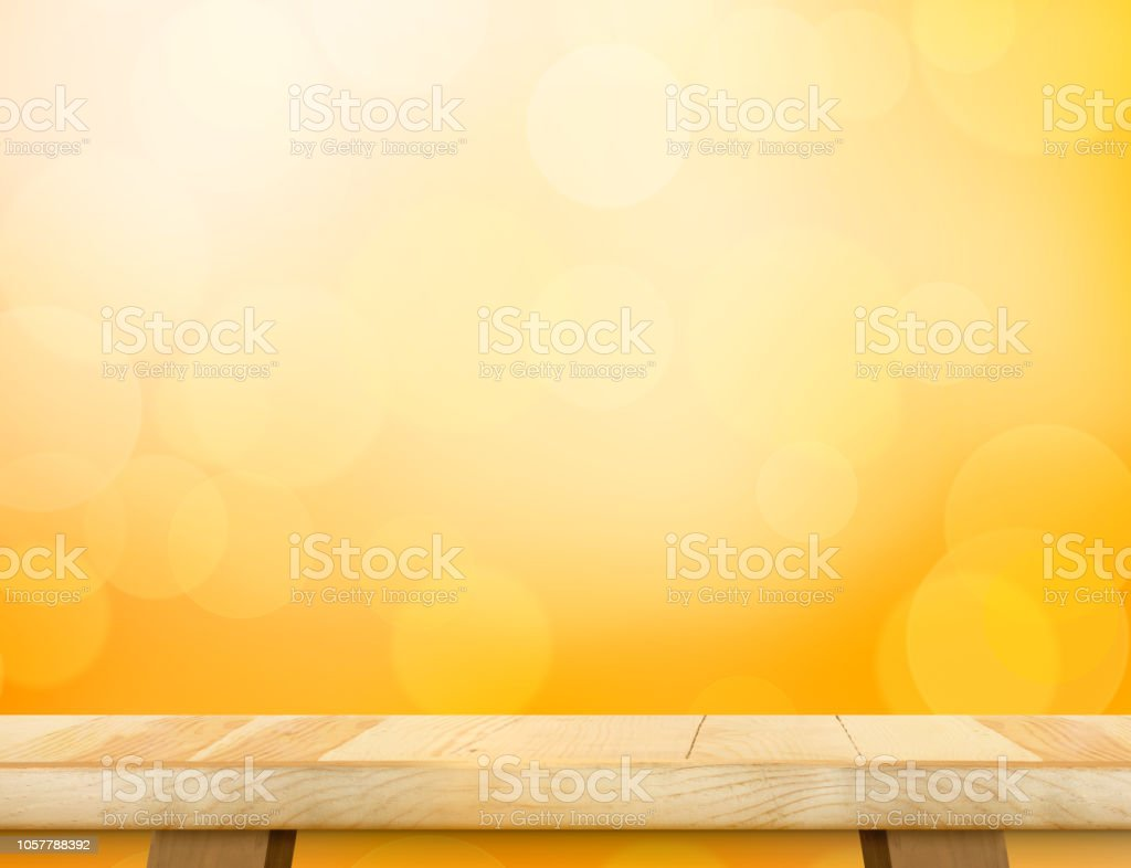 Empty wood table top (food stand) with abstract blur orange bokeh background,Autumn backgorund,Mock up for display or montage of product,banner for advertise on online stock photo