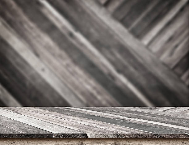 Empty wood table top with blur diagonal wood wall. stock photo