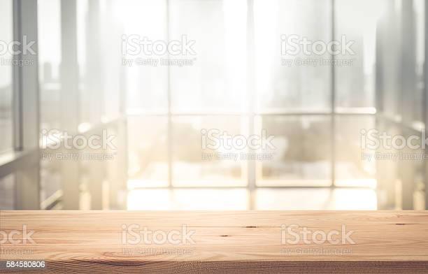 Empty wood table top with blur sunlight in window building picture id584580806?b=1&k=6&m=584580806&s=612x612&h=qgfd8fafqoxhnzzbwa24agpu7h0zmxoscdcmnmyawvw=