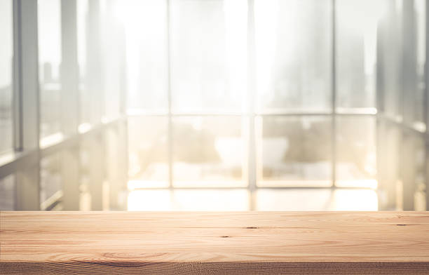 Empty wood table top with blur sunlight in window building 스톡 사진