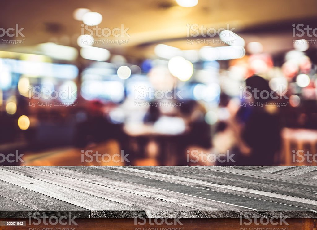 Empty wood table top with coffee shop blur with bokeh stock photo