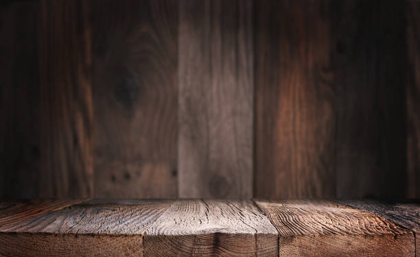 Empty wood table top with defocused wooden wall background. stock photo