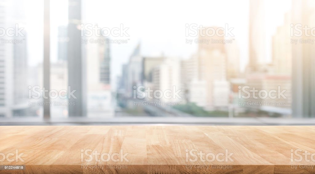 Empty wood table with blur room office and window city view background.For montage product display or design key visual stock photo