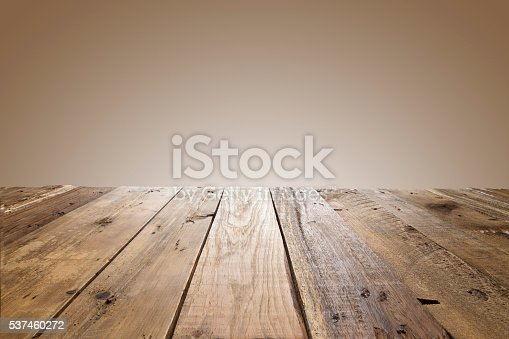 Empty wood table with brown background. Ideal for product display on top of the table. Predominant color is brown.
