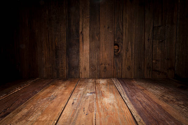 empty wood table with dark vertical table background - diminishing perspective stock photos and pictures