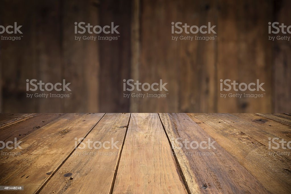 Empty wood table with defocused vertical table background royalty free  stock photo. Empty Wood Table With Defocused Vertical Table Background stock