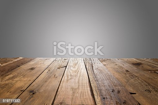 Empty wood table with gray background. Ideal for product display on top of the table.