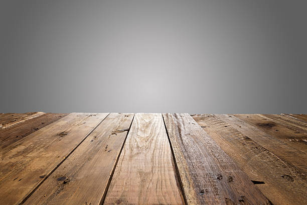 empty wood table with gray background - diminishing perspective stock photos and pictures