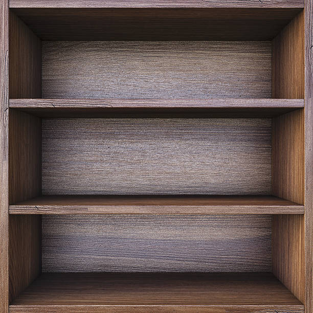 Empty wooden 3 tier shelf evenly spaced on black background stock photo