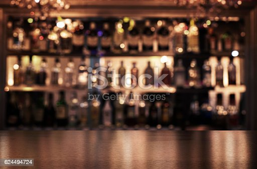 istock Empty wooden bar counter 624494724