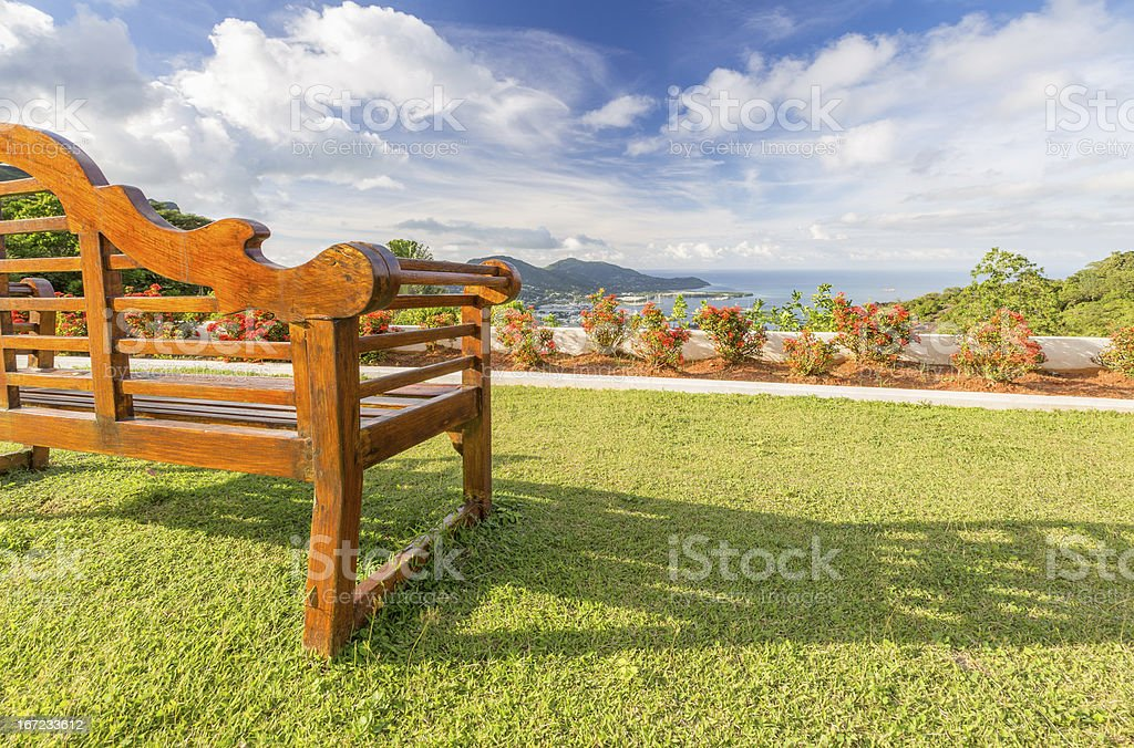 Empty wooden bench with a beautiful view royalty-free stock photo