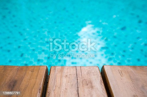 Empty Wooden board on the pool for background