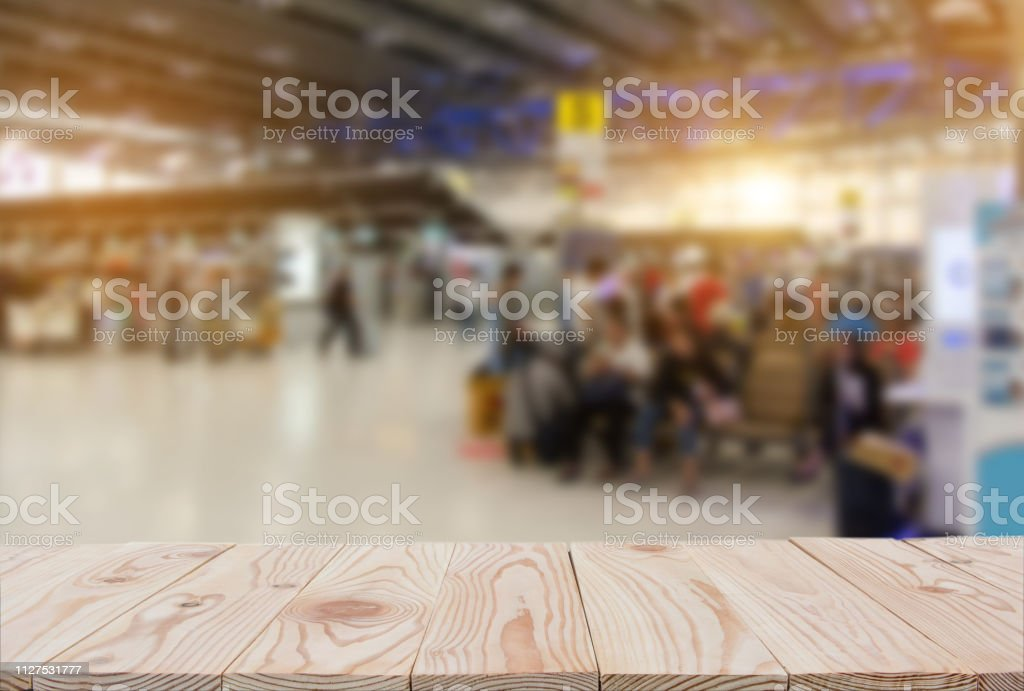 Empty wooden board table top on of blurred Passenger terminal...