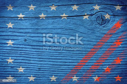 518726782 istock photo empty wooden board with american flag colors 455624121