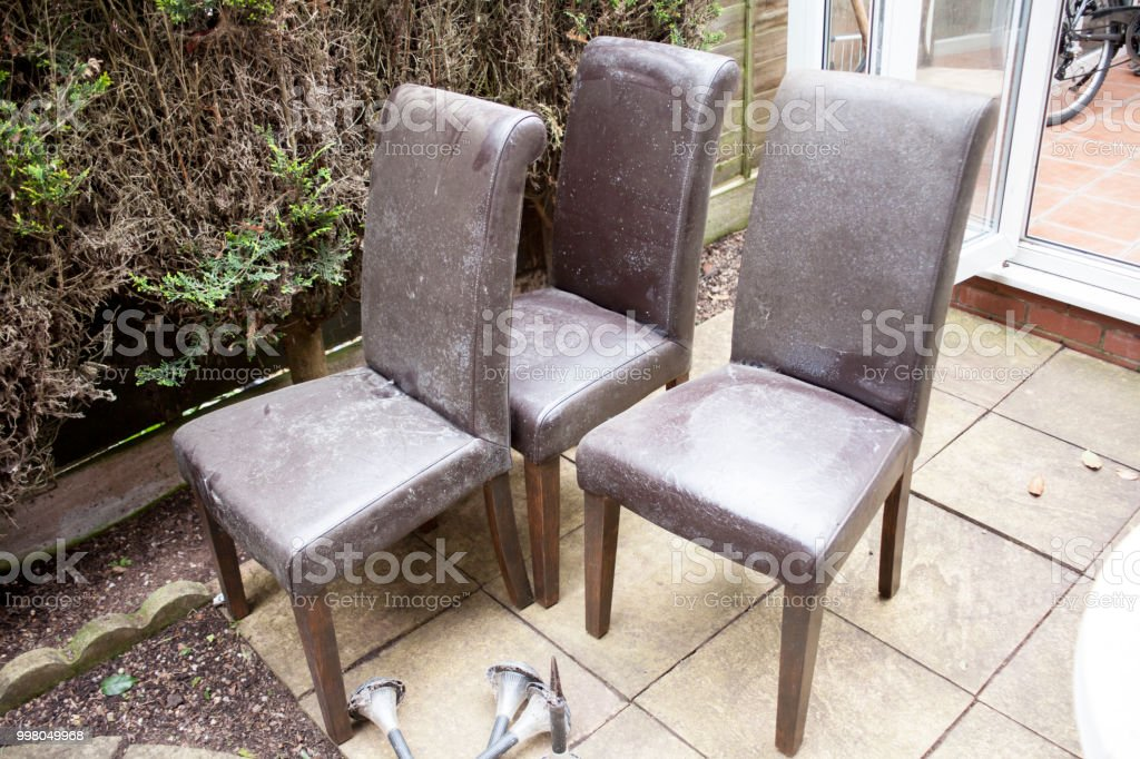 Empty Wooden Chairs In The Garden Old And Used Leathered ...