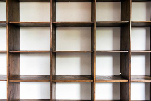empty wooden cupboard storage near white wall, modern interior closeup