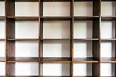 empty wooden cupboard storage near white wall, modern interior closeup interior