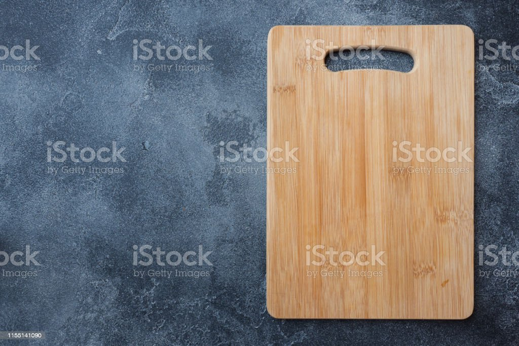 empty wooden cutting board on kitchen table. Top view copy space,