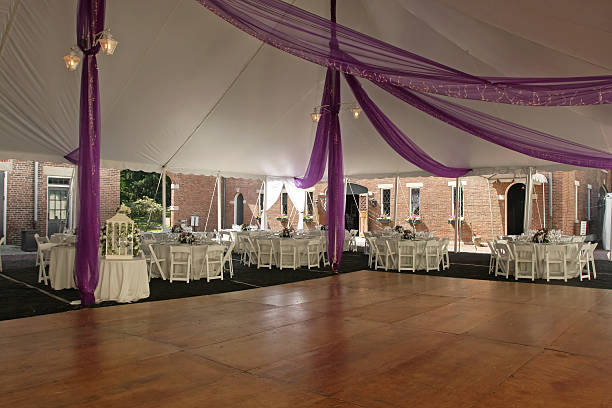 empty wooden dance floor inside wedding marquee with tables - dance floor stock photos and pictures