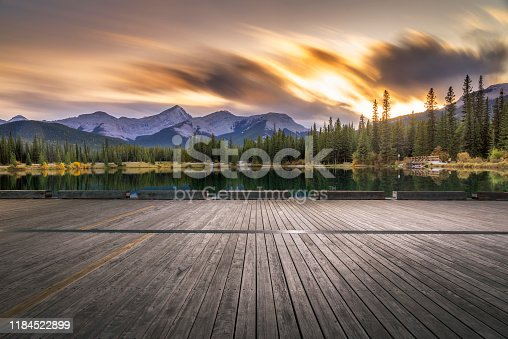Empty wooden deck front of Forget-Me-Not Pond at twilight,Alberta,Canada.