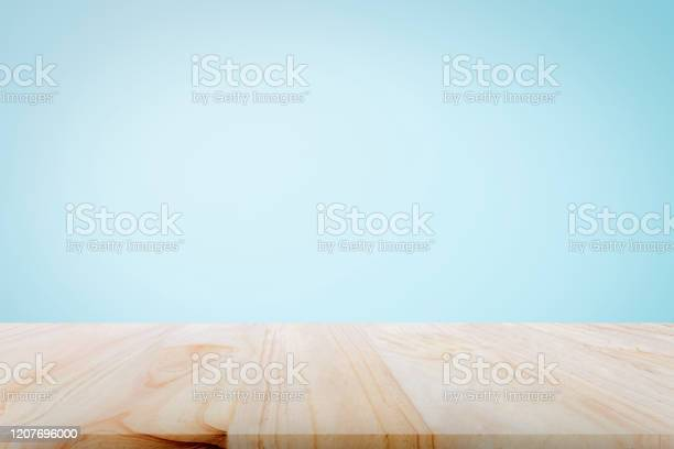 Empty wooden deck table over light blue wallpaper background for picture id1207696000?b=1&k=6&m=1207696000&s=612x612&h=s9rdfgay1qr2f6fri3ig moduswhw5ruozwuopkps3s=