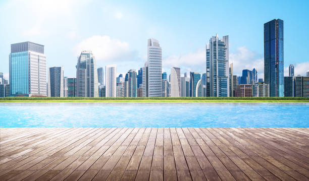 Empty wooden deck with swimming pool stock photo