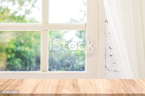 680878382 istock photo Empty wooden desk in the morning natural scene. Morning backdrops for your product. 929873362