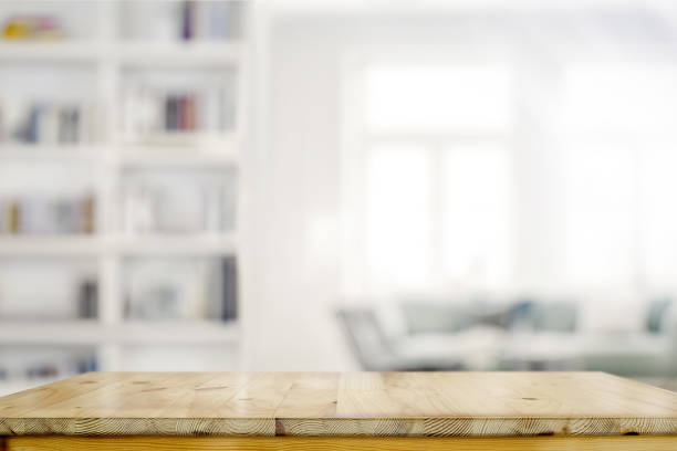 Empty wooden desk table in living room background Empty wooden desk table in living room background table stock pictures, royalty-free photos & images