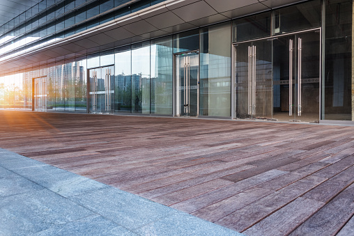 empty wooden floor nearby office building,china.