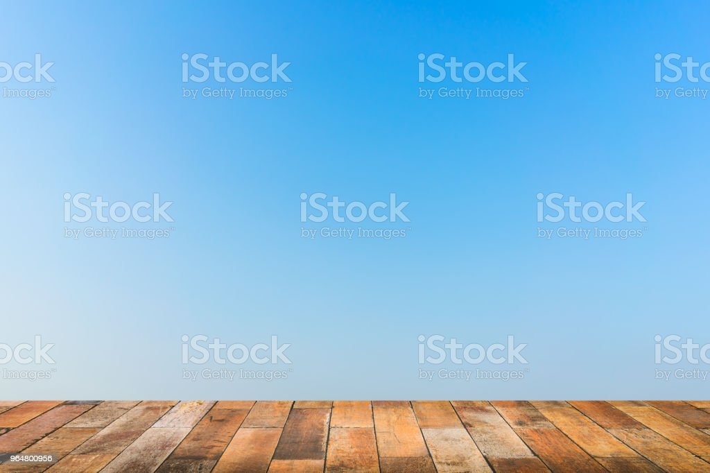 Empty wooden floor with blue sky background. royalty-free stock photo