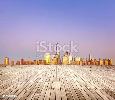 Empty wooden floor with cityscape