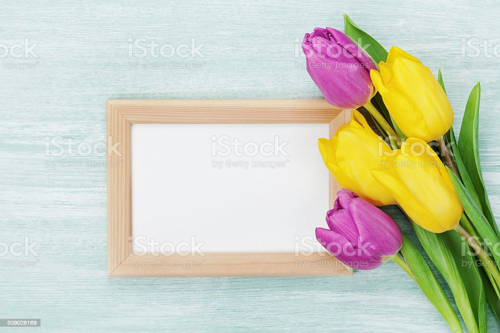 Empty Wooden Frame With Tulip Flowers For Message On Holiday Stock