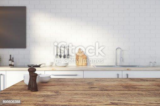 istock Empty wooden kitchen counter 895606388