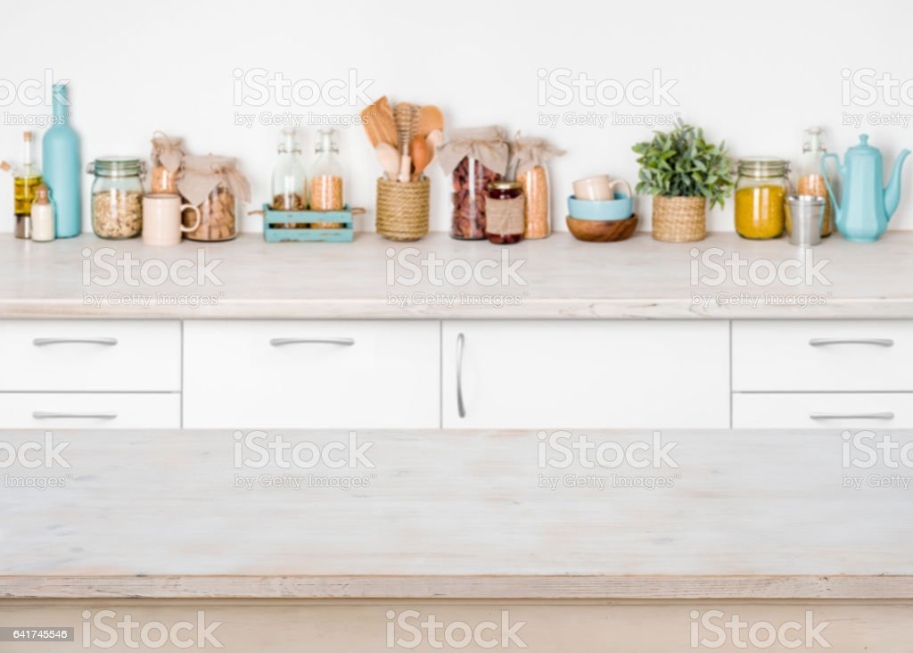 empty wooden kitchen table on blurred background of food