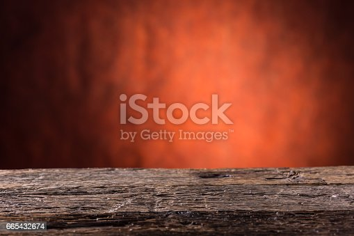 istock Empty wooden oak table and abstract red orange background.Free space for your product or information